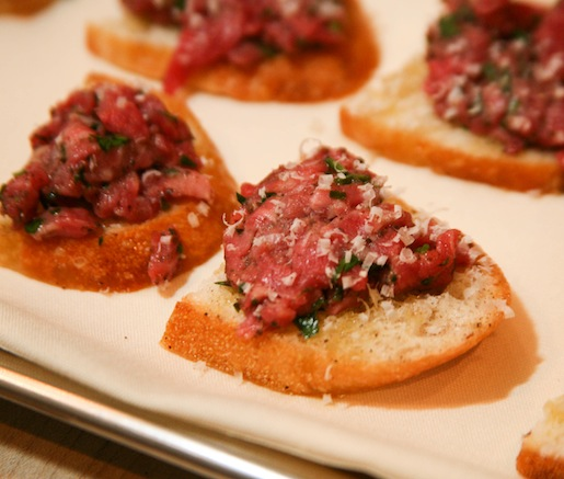 Piedmontese Beef Tartare with Truffle Essence and Parmigiano-Reggiano on Toasted Crostini